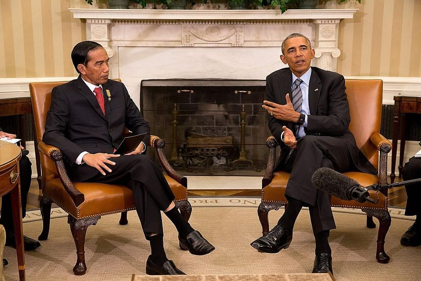 Indonesian President Joko Widodo (left) meeting US President Barack Obama in the Oval Office of the White House on Monday. The two leaders had wide-ranging discussions on issues such as maritime security, counter-terrorism and climate change.
