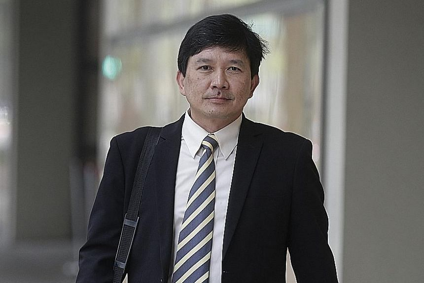 Forensic odontologist Tan Peng Hui (left) stated that the superficial injury on Iskandar Rahmat's hand was not a bite mark. Iskandar claims the elder Mr Tan had attacked and bitten him.