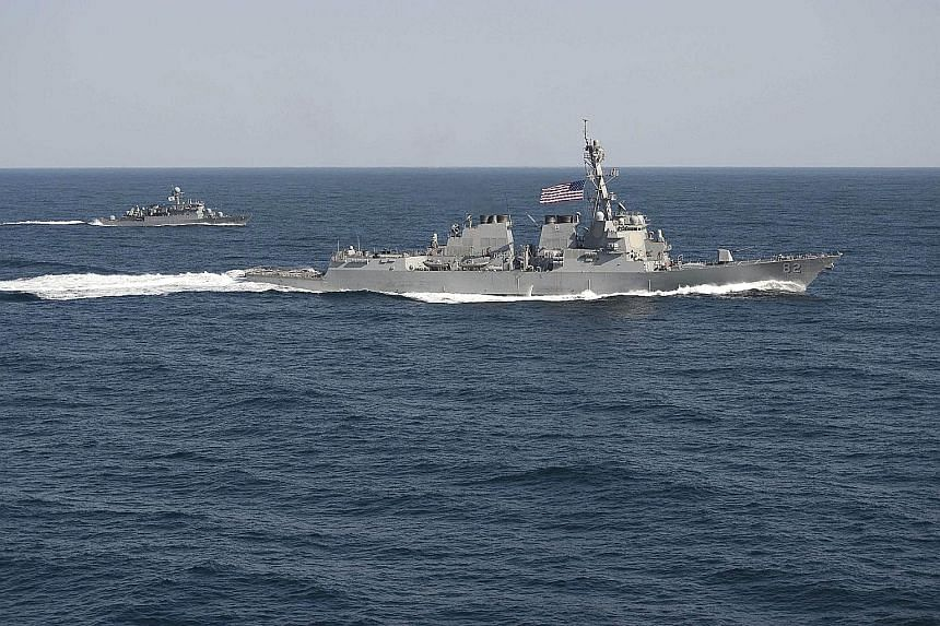 The USS Lassen (right) with a Republic of Korea Navy ship during an exercise east of the Korean Peninsula in March. The US vessel yesterday went within 12 nautical miles of islands China has built on the Subi and Mischief reefs.