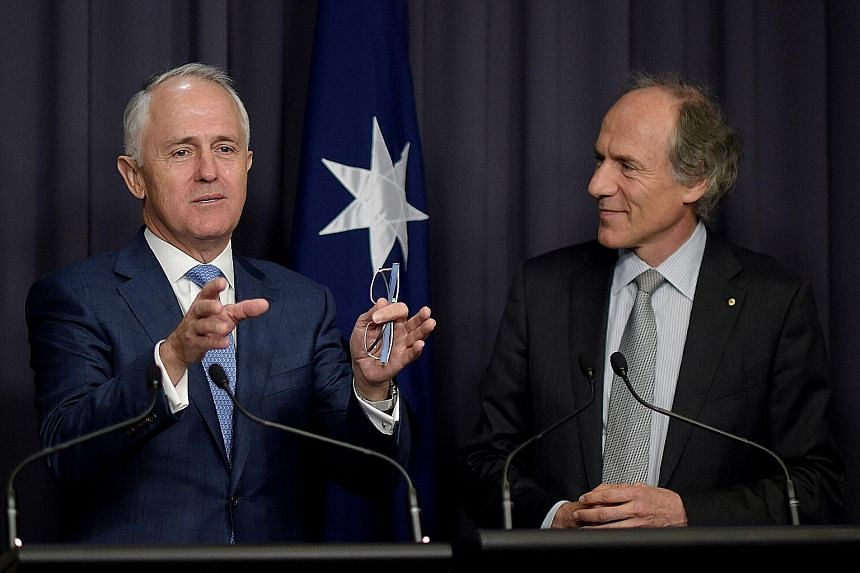 Australia's PM Malcolm Turnbull (far left) with incoming chief scientist Alan Finkel (left) at a press conference yesterday. Dr Finkel has advocated for an end to coal-fired power.