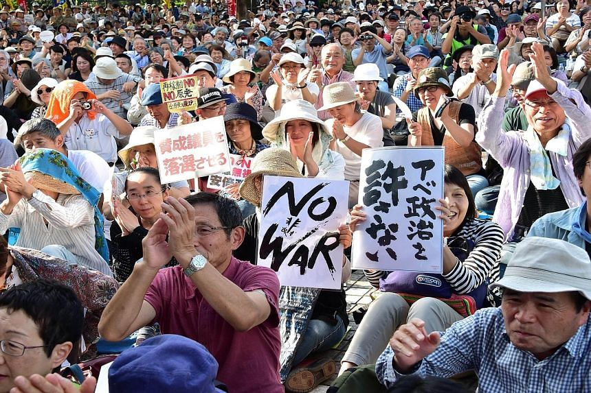 Demonstrators protesting against Prime Minister Shinzo Abe's security Bills and his nuclear policy in Tokyo last month. Okinawa has been battling Tokyo over the relocation of the Futenma airbase.