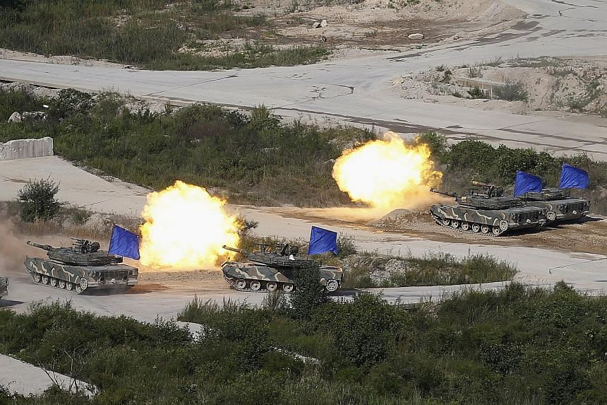 South Korean army K1A1 tanks in an exercise in a field near the demilitarised zone separating the two Koreas in Pocheon.