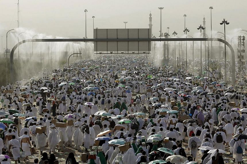 """Muslim pilgrims on the plains of Arafat, outside Mecca, during the annual haj last month. The paper's authors say that should the haj fall during the height of summer, it """"is likely to become hazardous to human health""""."""