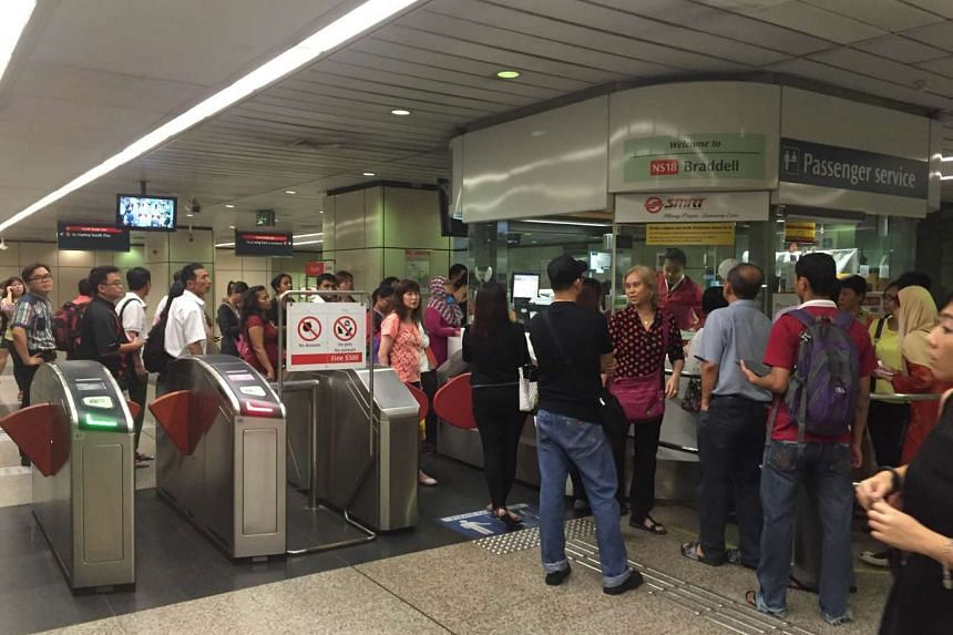 Commuters queueing up at the control station at Braddell MRT station after services on the North-South line were delayed by a train fault.