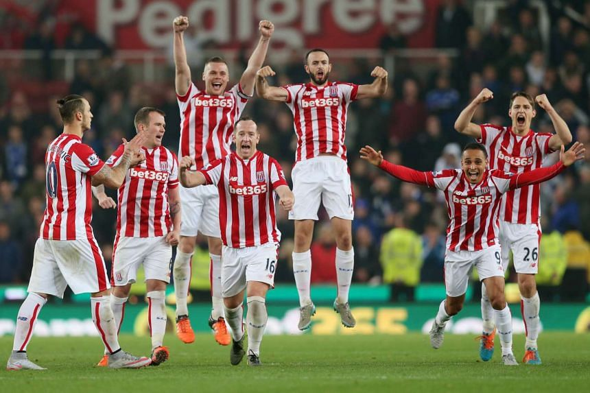 Stoke celebrate after winning the penalty shootout against Chelsea during the Capital One Cup Fourth Round football match.