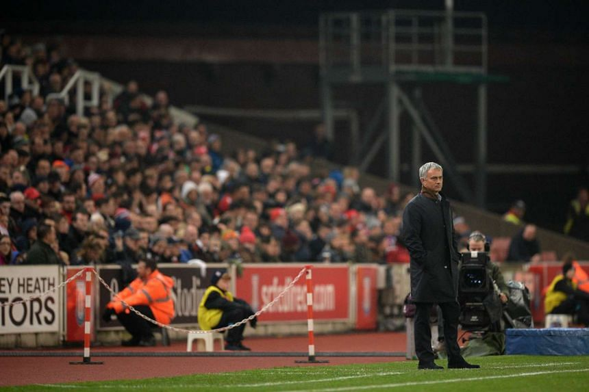 Jose Mourinho watches his players during the Capital One Cup Fourth Round football match between Stoke City and Chelsea.