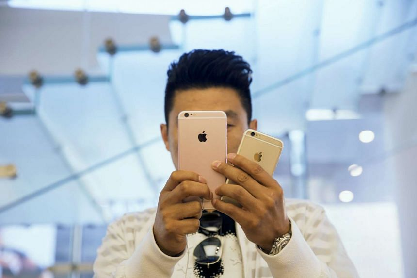 A man taking pictures at an Apple Store in Beijing on Sept 25, 2015.