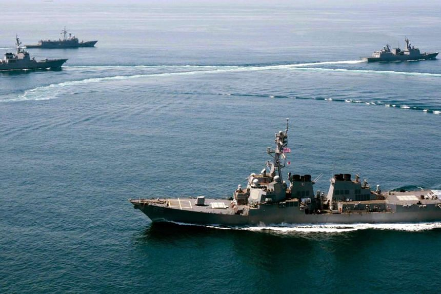 A handout photo released by the US Navy dated May 25, 2015 of the guided-missile destroyer USS Lassen (front) conducting a trilateral naval exercise with the Turkish and South Korean Navy in support of theater security operations in waters to the sou