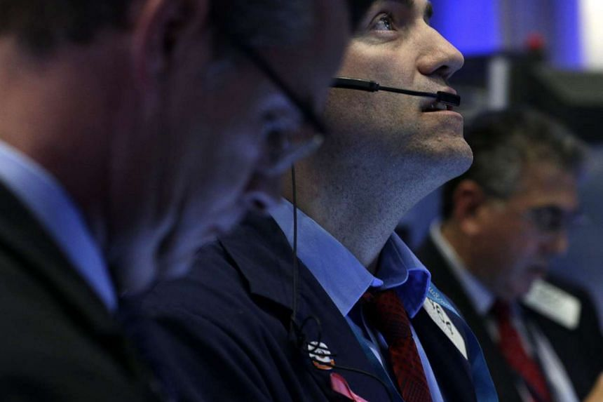 File picture of traders at the trading floor of the New York Stock Exchange (NYSE). PHOTO : EPA