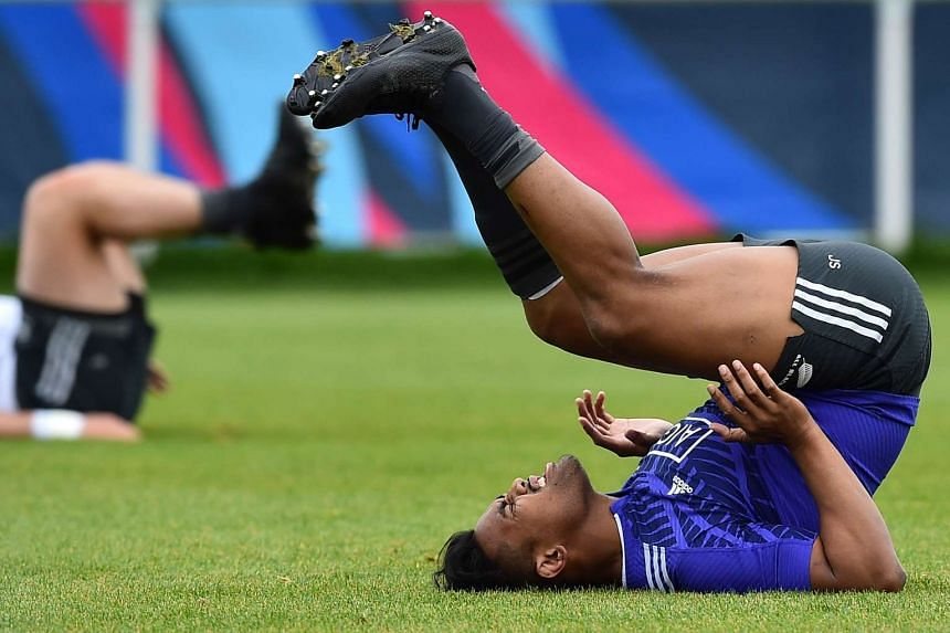 New Zealand's wng Julian Savea stretches during a team training session in Sunbury-on-Thames, west of London, ahead of the 2015 Rugby Union World Cup finals.