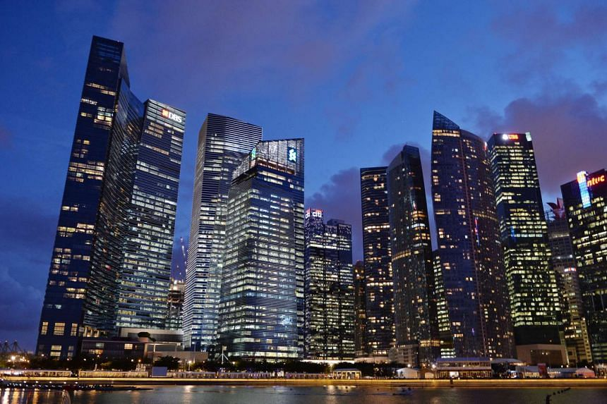 Marina Bay with the Singapore skyline at dusk. On the left of this cluster of skyscapers is Marina Bay Financial Centre (MBFC) with banks such as DBS and Standard Chartered.