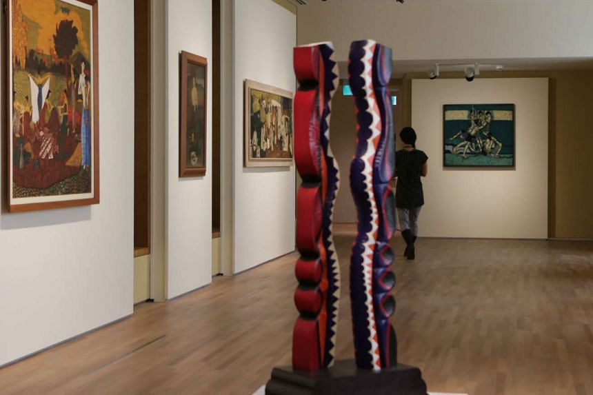 Indonesian artist G. Sidharta Soegijo's painted mahogany artwork, Lengkung Dinamika (Dynamic curves), is one of the pieces displayed in the UOB Southeast Asia Gallery.