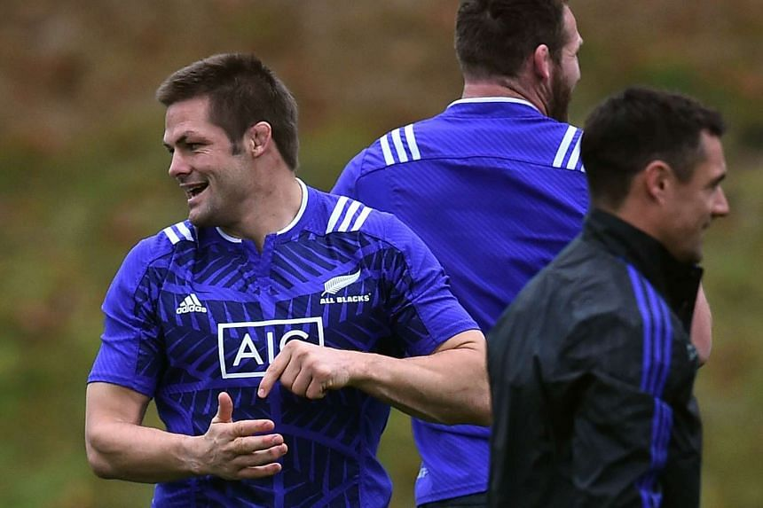 New Zealand's flanker and captain Richie McCaw (left) and fly-half Dan Carter (right) attend a training session at Penny Hill Park in Bagshot, south-east England, on Oct 27, 2015, during the Rugby World Cup 2015.