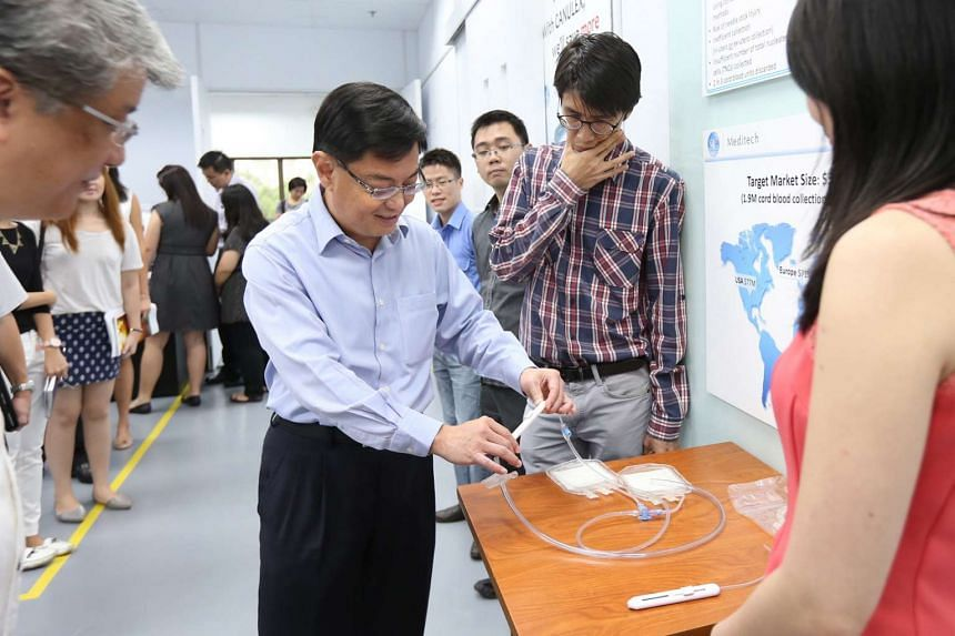 Finance Minister Heng Swee Keat touring a biomedical incubator at JTC LaunchPad @ one-north on Oct 2, 2015.