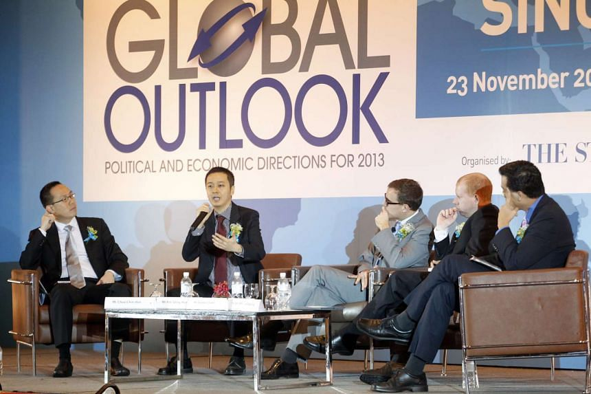 (From left) Straits Times US Bureau chief Chua Chin Hon and China Bureau chief Peh Shing Huei; StanChart's Mr Stephen Green and Mr Steve Brice; and forum moderator Nicholas Fang. (Right) Prof Tommy Koh was the keynote speaker.
