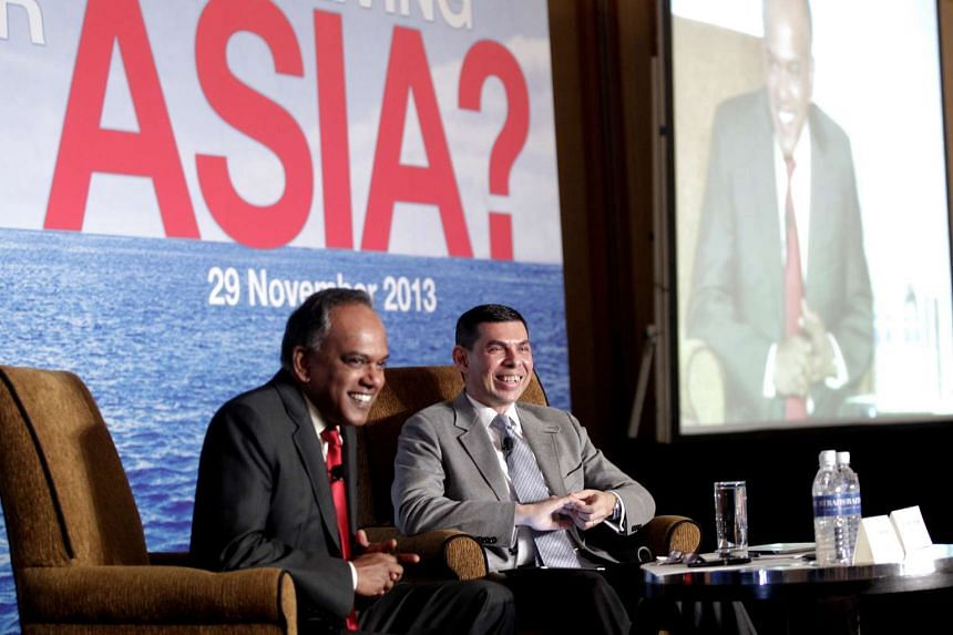 """Mr K. Shanmugam and Straits Times Editor Warren Fernandez at the second ST Global Outlook Forum yesterday. On the East China Sea tensions, the Foreign Minister warned that """"an incident can easily happen and we, the rest of the world, are to some ex"""