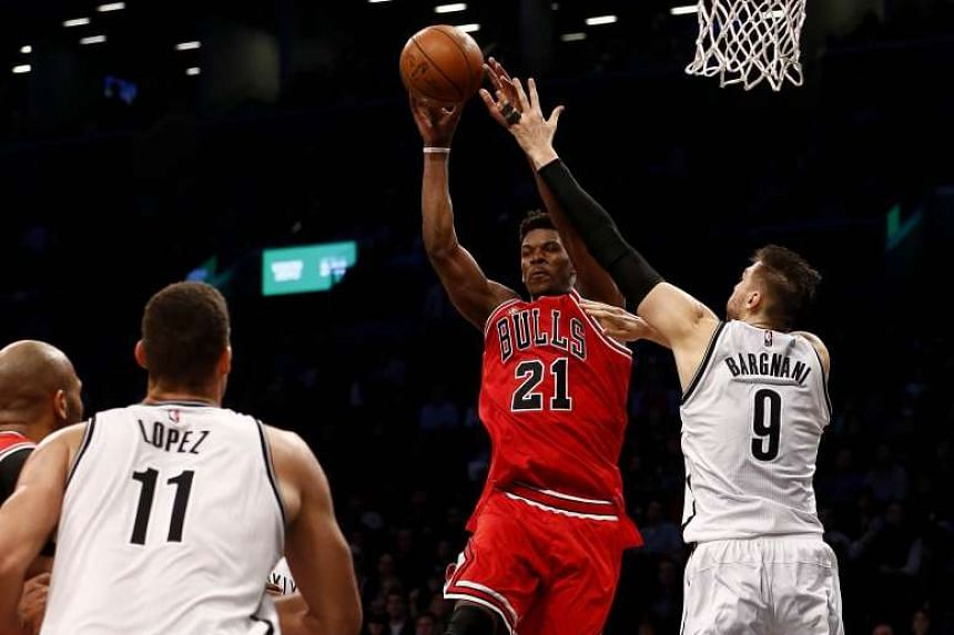 Jimmy Butler (#21) of the Chicago Bulls shoots over Andrea Bargnani (#9) of the Brooklyn Nets during their game at the Barclays Centre in Brooklyn on Oct 28, 2015.