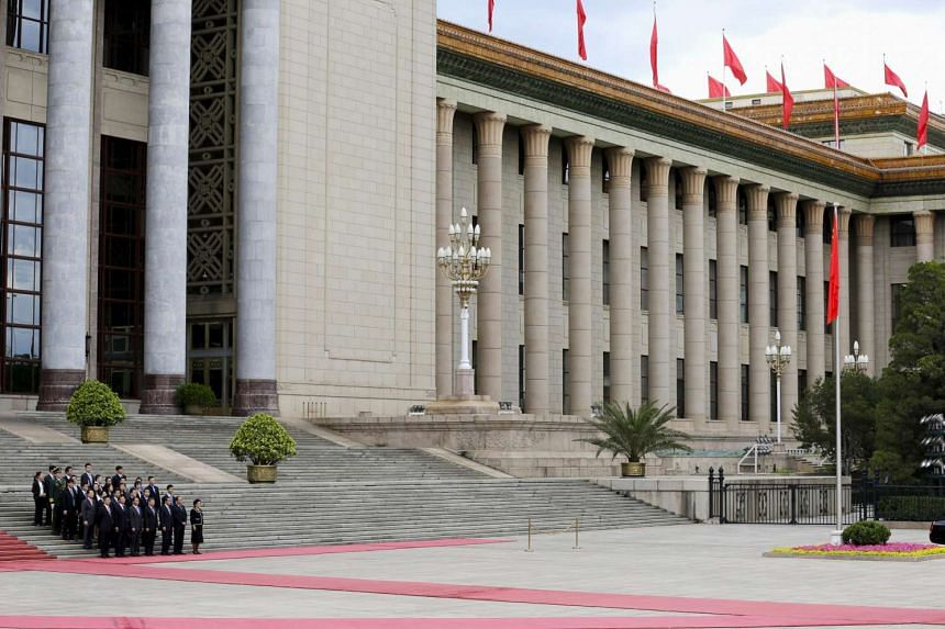 Senior officials waiting for a welcoming ceremony in front of the Great Hall of the People in Beijing on June 18, 2015.