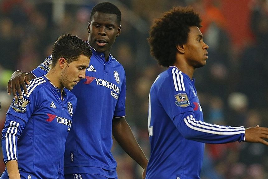 Eden Hazard (left) is consoled by Kurt Zouma after his penalty kick is saved by the Stoke custodian, ending Chelsea's defence of the League Cup.