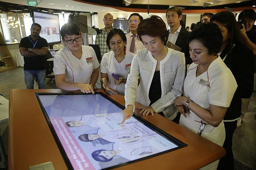Education and Trade and Industry Parliamentary Secretary Low Yen Ling trying a game at an exhibition at the Lifelong Learning Institute during the launch of iN.Learn 2020 and the opening of learning facility iN.LAB.