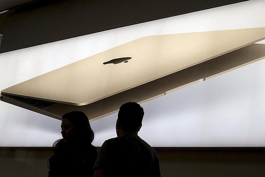 Employees at the SoHo Apple Store in New York. Apple is going into 2016 with a full slate of refreshed products.