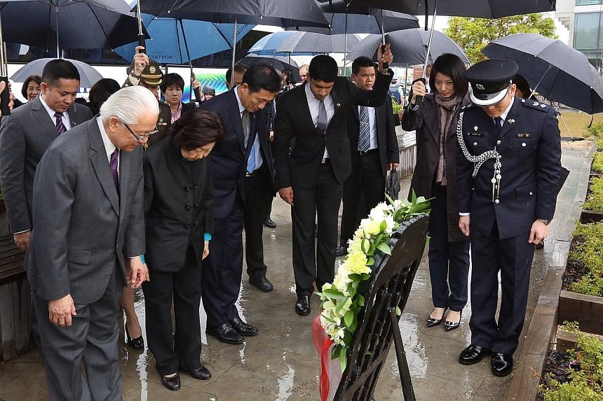 President Tony Tan Keng Yam (far left) paying his respects to victims of the 2011 earthquake at the Canterbury Television site. With him are (from left) Mrs Mary Tan, Acting Education Minister Ong Ye Kung, and MPs Vikram Nair and Sun Xueling.