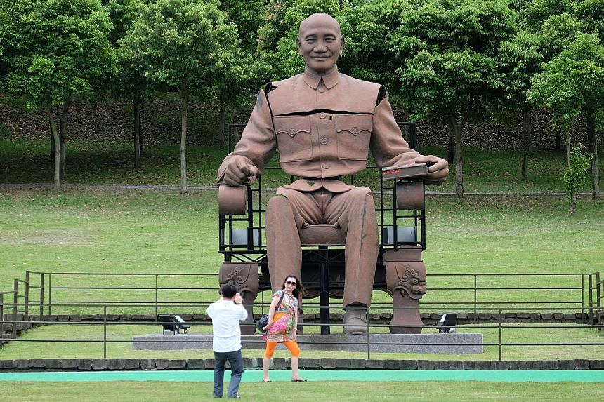 Chinese tourists visiting the statue of the late nationalist leader Chiang Kai-shek in a park in northern Taoyuan in May. Taiwan's government has said China will not radically cut the number of tourists it allows in around election time, but admits t