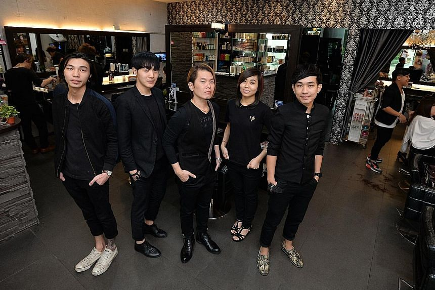 Vintage Studio director Vincent Ang (centre) with hairstylists (from left) Eugene Ng, Dowan Kim, Tracey Chin and Kidd Liang at the chain's Westgate outlet.
