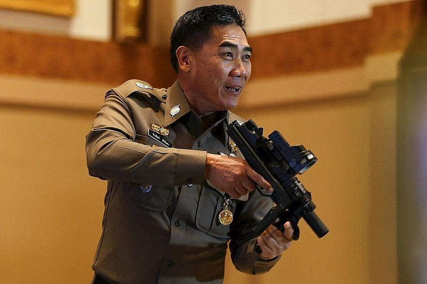 MONARCHY DAMAGED: These people made others wrongly believe that they were close to the monarchy... Their actions caused damage to the royal institution. - GENERAL JAKTHIP CHAIJINDA (above), with a confiscated gun.