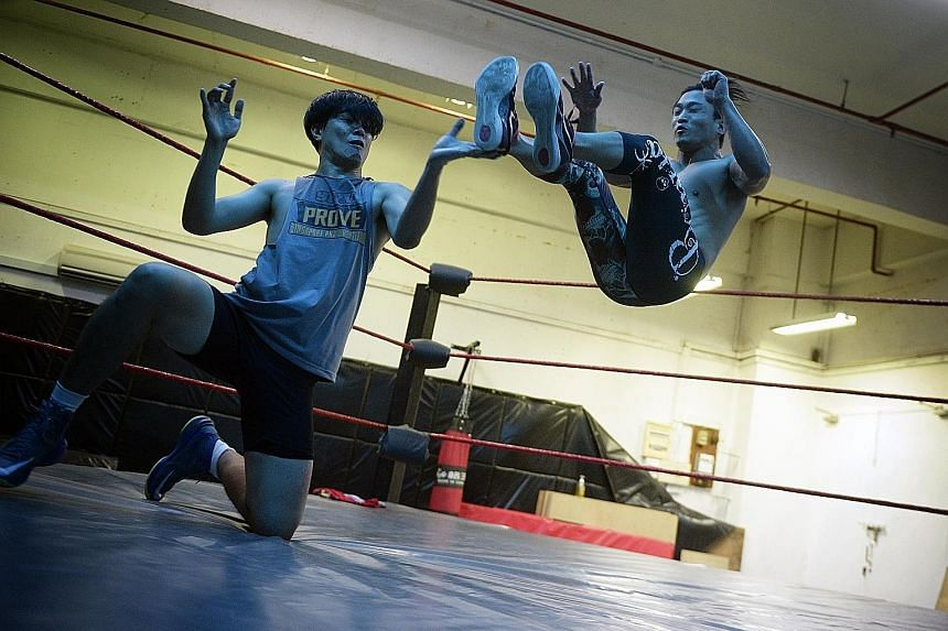 A week before the Singapore Pro Wrestling (SPW) show, Prove 5, Caleb Tan (left), practises with SPW co-founder Andruew Tang on Oct 17. SPW has a school which trains its wrestlers, and prepares them mentally and psychologically.
