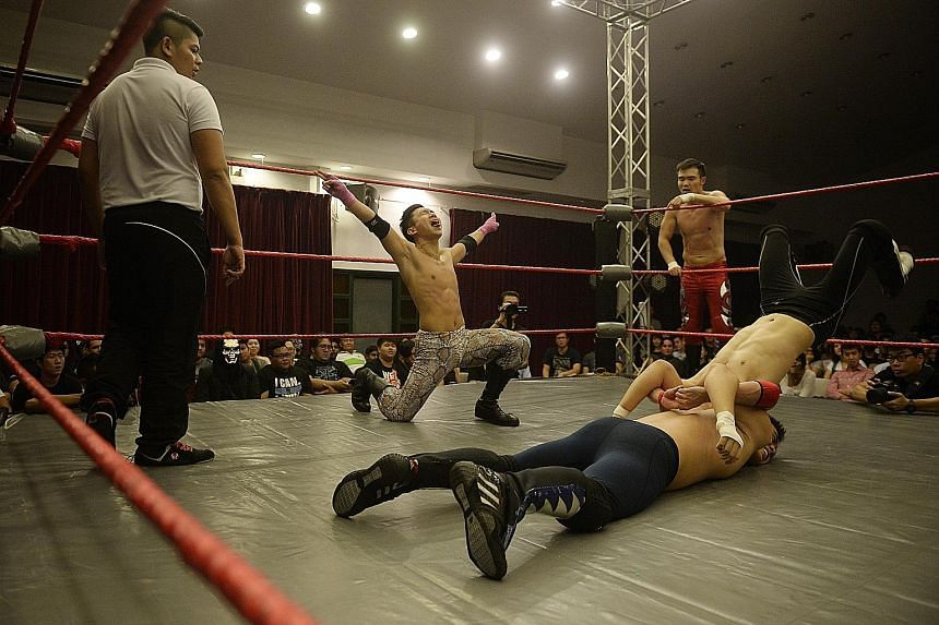 The Ladykiller (Dennis Hui, centre), 29, makes a big display of machismo before executing a move during a tag team match in Prove 5. Theatrics form a large part of pro wrestling entertainment.
