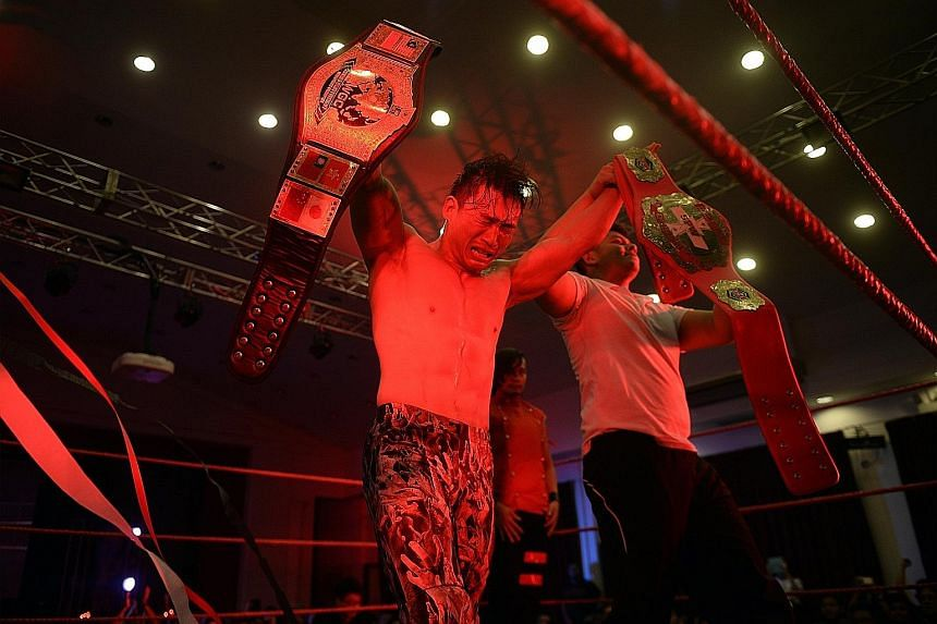 At the end of Prove 5, The Statement (Andruew Tang) is declared the new South-east Asian Championship winner and is presented with the title belt (right) while he holds his Hong Kong Championship belt (left) which he won last year.