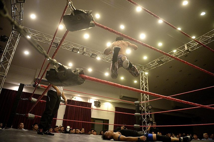 The Statement (Andruew Tang), 26, leaps into the air and finishes off Arsenal Affi (Muhammad Affi Aidat Othman), 25, at the main event of the recent SPW show, Prove 5. Storylines often pit a good guy against a bad one.
