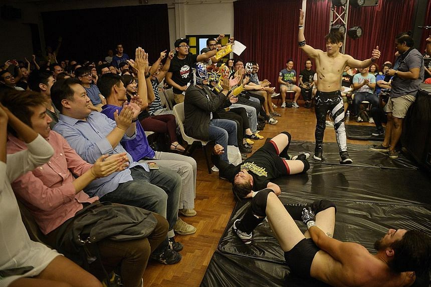 Sergeant Nick (Nicholas Lee), 23, riles up the crowd after grounding Australian wrestlers Renegade (Toby Kiddle, in black shirt), 21, and Lynx Lewis Jr (Sam Bradley, right), 22, during the SPW show, Prove 5, last Friday.