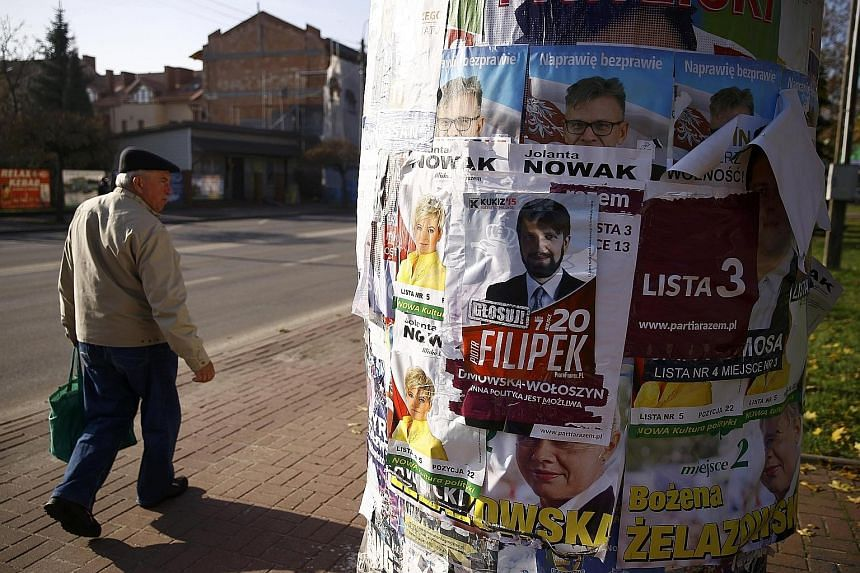 A pillar covered with election posters in Radzymin near Warsaw. Civic Platform lost because it failed to explain to Poles that elections are a choice, not an auction between competing lists of promises, with victory simply going to the highest bidder