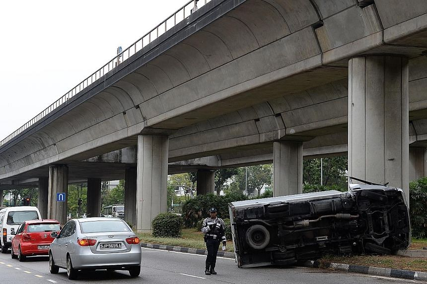 The lorry landed on one side after crashing into a bridge support pillar shortly after 8.30am yesterday. The 33-year-old driver, who was conscious, had to be extricated from the wreckage.