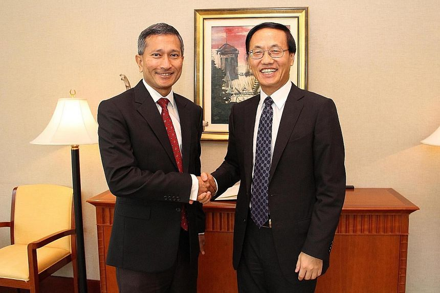 US Ambassador Kirk Wagar (far left) paying Foreign Minister Vivian Balakrishnan an introductory call on Tuesday. Yesterday, Dr Balakrishnan met Chinese Ambassador Chen Xiaodong (above, right).
