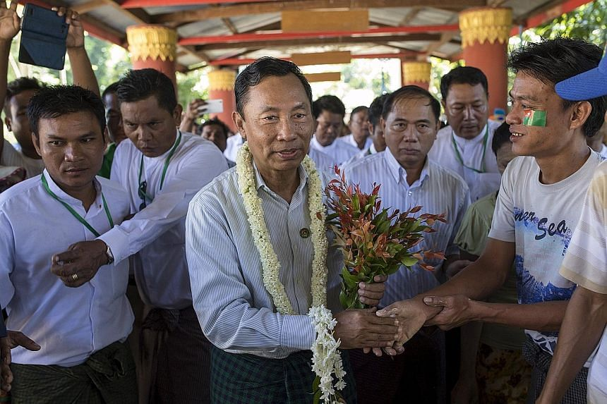 Lower House Speaker Shwe Mann (centre) greeting supporters as he campaigned in his constituency in Phyu earlier this month.