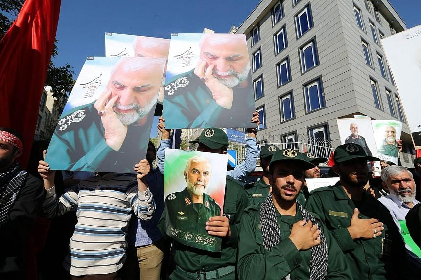 Members of the Revolutionary Guards at an Oct 11 funeral procession in Teheran for top commander Hossein Hamedani, who was killed in Syria. This week's talks on ending the Syrian conflict will be the first time the US will enter formal negotiations w