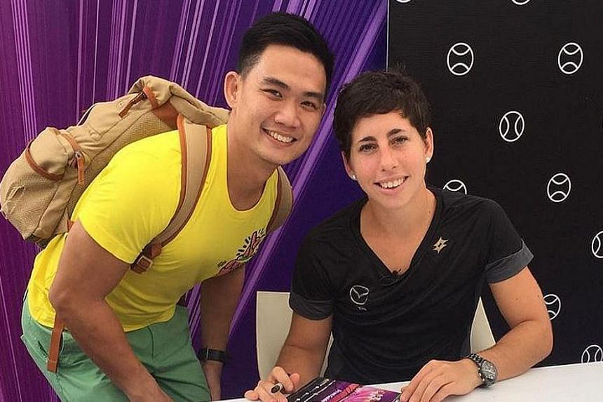 """""""With Carla Suarez Navarro! She's so kind!"""" A lucky fan got to meet the Spaniard, here to play doubles, at the Fan Zone yesterday."""