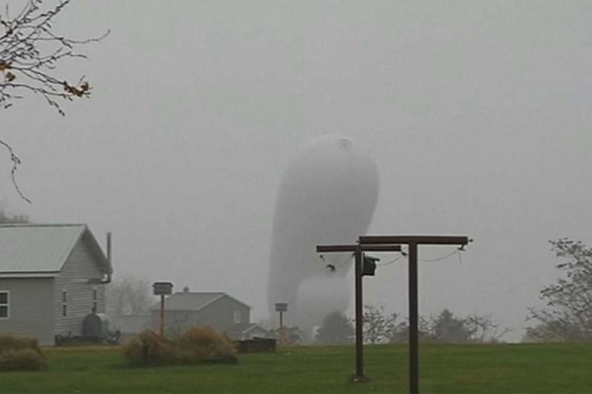 A high-tech US military blimp designed to detect a missile attack is pictured coming to the ground in Montour County, Pennsylvania.