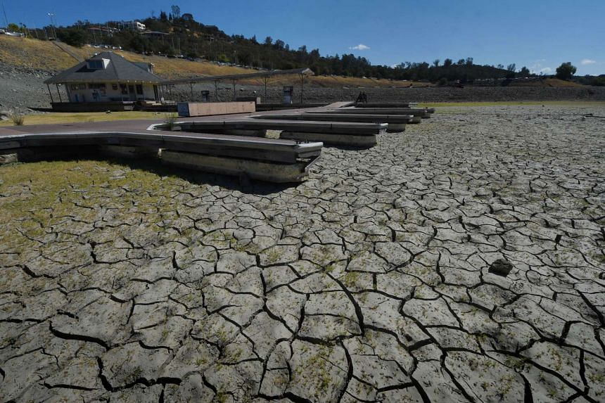 Boat docks sitting empty on dry land, as Folsom Lake reservoir near Sacramento stands at only 18 per cent capacity during the severe drought in California.
