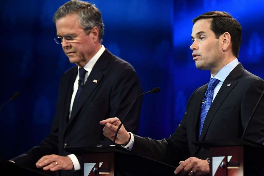 Republican Presidential hopeful Marco Rubio (right) speaks as Jeb Bush looks on during a debate at the University of Colorado on Oct 28, 2015.