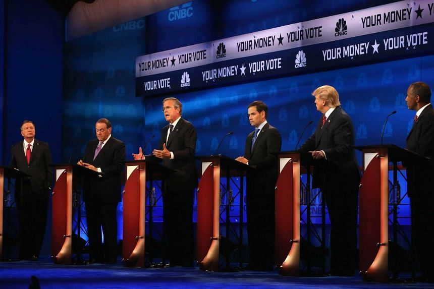 Presidential candidates (from left) John Kasich, Mike Huckabee, Jeb Bush, Marco Rubio, Donald Trump and Ben Carson take part in the CNBC Republican Presidential Debate at the University of Colorado on Oct 28, 2015.