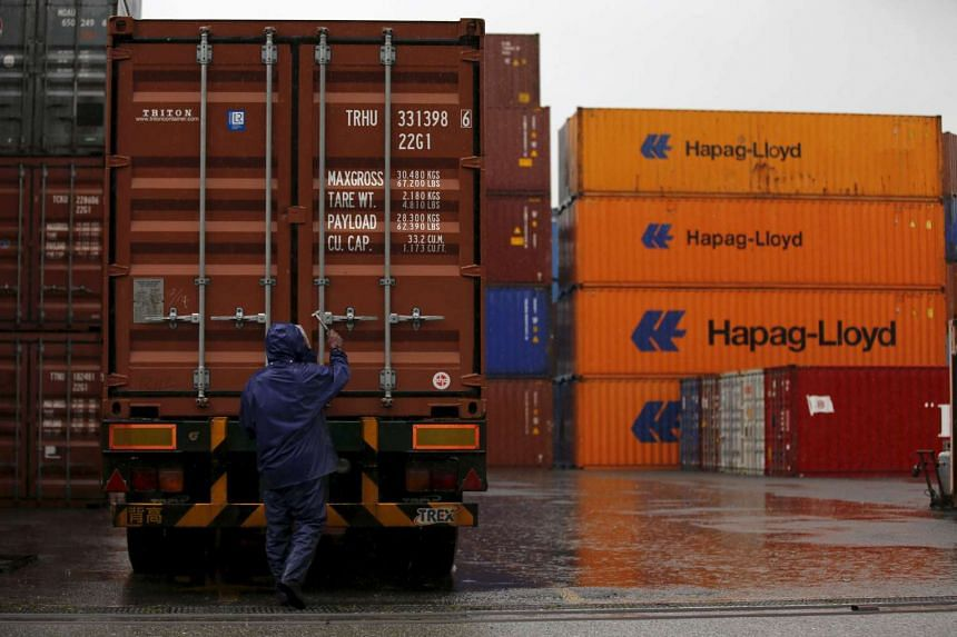 A man works at a container area at a port in Tokyo, Japan on Sept 8, 2015.
