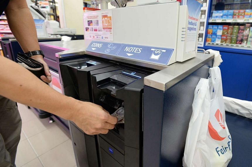 Shoppers using the new iCash system at NTUC Fairprice located at Blk 308C Punggol Walk on Oct 28, 2015.