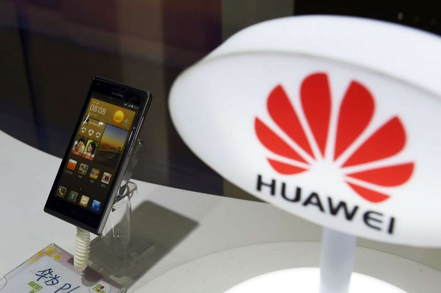 A mobile phone made by Chinese telecom equipment maker Huawei displayed in a store in Beijing on Aug 3, 2015.