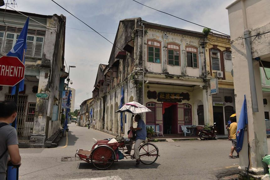 Shophouses in Georgetown, Penang. Penang's city of Georgetown is No. 4 in Lonely Planet's Top 10 Cities list for Best in Travel 2016.
