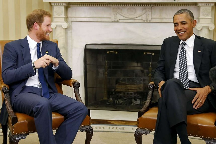 US President Barack Obama speaking to Britain's Prince Harry (left) during a meeting at the White House in Washington, DC, on Oct 28, 2015.