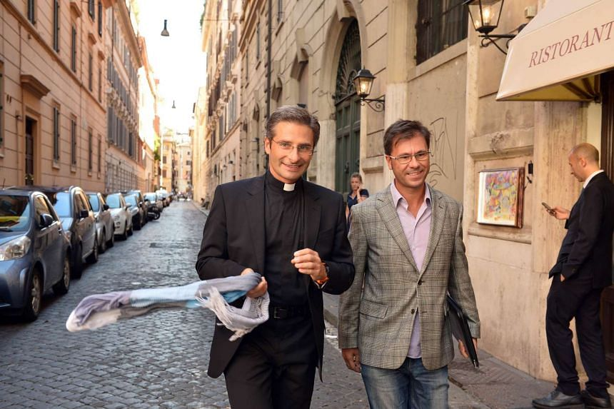 Father Krysztof Olaf Charamsa (left) arrives with his partner Edouard to reveal his homosexuality during a press conference on Oct 3 in Rome.